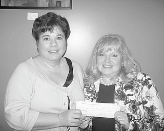 Proceeds from a benefit fashion show sponsored by Mahoning County Medical Society Alliance on Feb. 25 at Avion on the Water in Canfield were converted into seed money for the Garden of Hope at Akron Children's Hospital Mahoning Valley. Paula Jabubek, outgoing president of the alliance, left, had the honor of presenting a check for $10,000 to JoAnn Stock, hospital development director, during a May 6 meeting of the alliance at Rosetta Stone Café, downtown Youngstown. With the check, the alliance has donated a total of $15,700 toward its pledge of $22,500 to the garden. For more information on the garden, call (330) 746-9122.