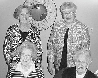 Mu Chapter of Delta Kappa Gamma Society International met April 19 at Donavito's Italian Grille in Struthers to honor members who joined the sorority during the 1950s and 1960s. Four of the honorees attending the meeting are, seated from left, Mary B. Smith (1963) and Frances Ritz (1964), and, standing from left, Ruth Stevenson (1955) and Leslie Kiske (1964). They shared memories of past meetings, and each received a pot of tea roses. Honored in absentia were Helen Day (1959), Ruth Forsythe (1963), Margaret Remias (1964), Lillian Jacobs (1965), Betty Miller (1957) and Bessie Veck (1966).