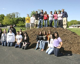 ROBERT K. YOSAY | THE VINDICATOR..the 11th and 12th grade class at McDonald High School - will have a POSITIVE IMPACT DAY  on Wednesday - where the students in Mr. Chris Rupe will clean up and put down mulch at School properties and Woodland Park in McDonald on WEDNESDAY - they were going to do the deed on Tuesday but it was changed for the weather - l-r - Back Row.Shawn McCune -11, Eric Shehadi 11, Conor Banyon-12. Corey McClain 12, Haley McCormick 12, Jenna Saborse 12,  Michaela Lepor 11 - Taylor Plesea 12 - and Mr Chris Rupe-.FRONT ROW -Chalsea Turkovic 11, Nicole Turkovic 12 Stephen Mohamed 11 Hannah Rebraca 11 Danielle Ferraro 11, Delaney Fowler 11 - Katie Joseph 11 - Taylor Garland 11  MIDDLE ROW - Chelsea  Moritz  ( black) Laure Mark 12  and Layla Nagi 11 -