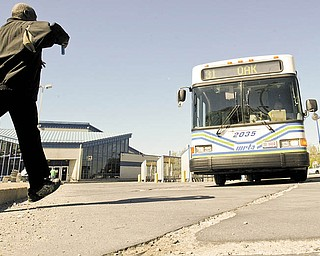 A rider hurries to board a WRTA bus in downtown Youngstown.