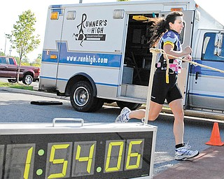 Marisa Facchini crosses the finish line after competing the triathlon at the YMCA in Boardman..
