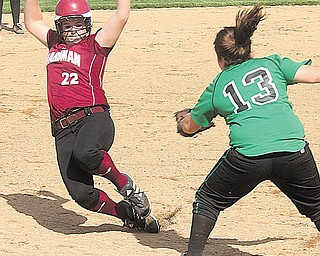 SOFTBALL - (22) Brooke Meenachan of Boardman tries to beat the tag of (13)  Jo Bondra during their game Wednesday afternoon in Boardman.