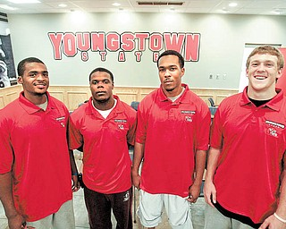 Youngstown State's four newest football recruits, from left, Grant Mayes  Adaris Bellamy, Julian Harrell and Will Shaw, said on Wednesday that the new coaching staff and the school's facilities played the biggest factors in their joining the team.