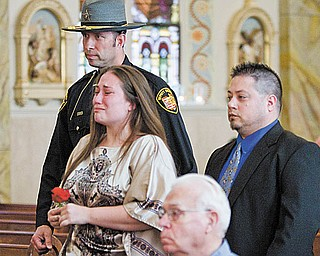 Mahoning County Deputy Sheriff John Marenkovic escorts Marisa Litch of Struthers at the ceremony. Behind them is her brother Bobby Litch of Campbell. Their father, John ÒSonnyÓ Litch of the sheriff Õs department, was shot and killed Oct. 22, 1981.