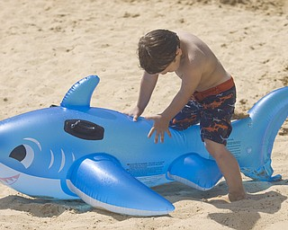 LISA-ANN ISHIHARA | THE VINDICATOR..Kaiden Jewell (4) of Hudson hangs out with his inflatable shark during day one of Jonesfest at Nelson Ledges Quarry Park.