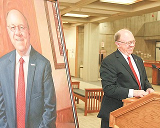 Youngstown State University President David C. Sweet stood next to a mirror image of himself at the unveiling of his official presidential portrait. It will hang in the foyer of Tod Hall along with the portraits of the university's first five presidents. Sweet's 10-year tenure at the helm ends with his retirement June 30.