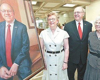 Youngstown State University President David C. Sweet is flanked by two key women in his life, his wife, Pat, left, and his mother, Esther Sweet, as they admire his official presidential portrait.