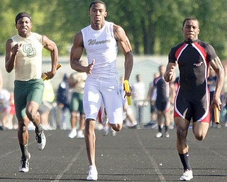 Warren Harding senior DeAver Williamson, shown here running in the 4x100-meter relay at last weekend's Division I regional meet, will look to lead the Raiders to the title at this weekend's state meet. Williamson is the defending state 100 champion.