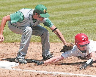 Michael Lehmkuhle, The Advocate.Newark Catholic's Kevin Cox tags out Columbiana's Andrew Burdick after a throw-back to first base Thursday afternoon during the Green Wave 1-0 victory advancing them to the Division IV state title game.