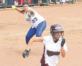 Poland's (23) Jenna Modic makes a play on a bunt attempt as (4)Regan Buchanan tries to beat the throw Thursday afternoon in Akron.