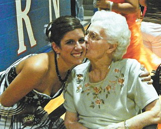 Kristin OÕConnell of Western Reserve High School in Berlin Center gets a kiss from her Grandma OÕConnell during the 2010 Promenade.