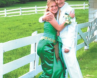Leanna Hartsough, a Canfield High School junior, and her date, Mike Drotleff, a senior, are at Speece Lake in Canfield.