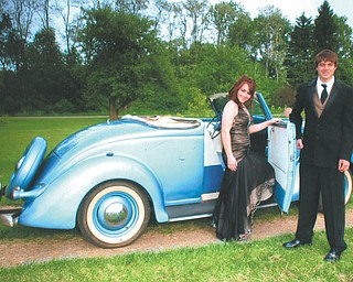 Aaron Hartsough and Rachael Morris are preparing to leave for the Canfield High School prom.