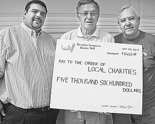 The Greater Youngstown Italian Heritage Foundation and the Greater Youngstown Italian Fest contributed $5,600 to local charities after its festival last year. Above with an oversized check representing the proceeds are 2009 officials, from left, John Rossetti, president; Ray Greco, fest chairman; and Anthony Julian, foundation treasurer. The 25th anniversary edition of the fest is scheduled for July 30 through Aug. 1. For information, call Julian at 330-207-0515 or 330-799-8184.