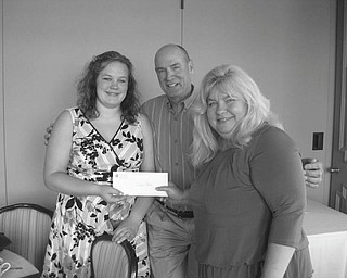 A highlight of the May 20 meeting of Youngstown Lions Club was the presentation of the Rita Merz Memorial Scholarship to Youngstown State University, given in memory of Rita Merz, who had been a member of the Lions Club. The recipient is chosen by members of her family. Presenting the award to Stephanie Baker, left, a graduate of Leetonia High School, are Paul Merz and Jeannie Antol-Watson. The Lions are setting up an endowment so a similar scholarship can be awarded annually.