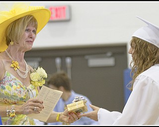 Geoffrey Hauschild|The Vindicator.Retiring teacher, Barbara Stacy, receieves a gift from Danielle Sabelli on behalf of her graduating class during Poland's 2010 Commencement Ceremony at the high school gymnasium on Sunday afternoon.