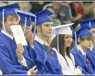 Geoffrey Hauschild|The Vindicator.Cooper Kostelic clowns around during Poland's 2010 Commencement Ceremony at the high school gymnasium on Sunday afternoon.