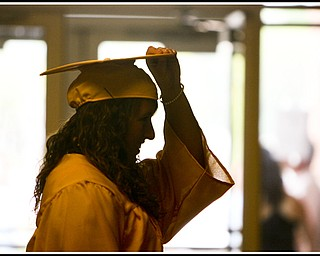 ROBERT K. YOSAY | THE VINDICATOR...Last minute check is Cori Pavlicko who also  was one of the valedictorian's  at Lowellville High School gym - the glass of 2010 - graduated Sunday afternoon-30