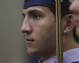 ROBERT K. YOSAY | THE VINDICATOR...Jim Perry listens intently to the Valedictorians = at Lowellville High School gym - the glass of 2010 - graduated Sunday afternoon-30