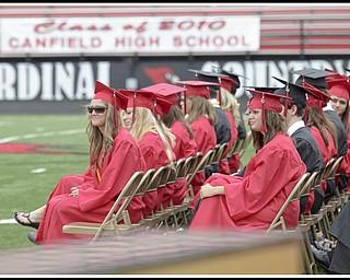 "LESLIE CUSANO | THE VINDICATOR.Canfield graduates listen to the Canfield High School choir sing ""A Closing Prayer"" by Don Besig."