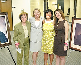 Portraits were unveiled at the Martin P. Joyce Juvenile Justice Center on East Scott Street in Youngstown. At left is the portrait of Judge Joyce. At far right is the portrait of Judge James McNally. Between the portraits are, from left, Betty Joyce, wife of the late Judge Joyce; Judge Theresa Dellick of juvenile court; Linda McNally, wife of the late Judge McNally; and Kerry McNally, the judgeÕs daughter, who recently graduated from law school. The portraits were unveiled at a ceremony Monday.