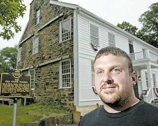 The Old Stone Tavern, the oldest building in Poland, is for sale. The South Main Street structure was built in 1804 and has been an antiques shop for the last few years. Realtor Paul Sherman of Town One Realty, which is listing the property, stands outside of the landmark.