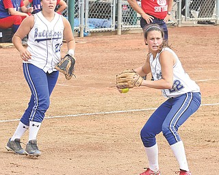 Poland's Erin Gabriel makes a play on the ball as (23) Jenna Modic keeps her eye on the play.