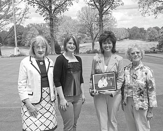 In keeping with its goal of furthering an interest in Catholic education, Catholic Collegiate presented two scholarships at its final meeting of the season. Pictured following the presentation ceremony are, from left, Barbara Banks, first vice president; Jenna Hallapy, a scholarship recipient; Tammy Porter, holding a picture of her daughter Courtney Porter, a scholarship winner; and Mary Place Thomas, scholarship chairwoman.