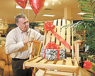 Wiilliam D. Lewis |The Vindicator  Lazy Boy store owner ron D'Alseandro shows off a relpica of the original Lazy Boy chair.