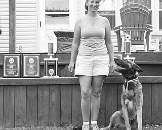 A special dog has his day: Dog trainer Aimee Markle, of Youngstown, traveled to Baltimore for a Protection Sports Association working dog competition the weekend of June 5. Markle, who has been training and caring for pets for several years, began training her own dog, Funez, which is pictured, for competition in 2008. Funez, a 3 1⁄2-year-old German Shepherd and Malinois, is trained in obedience and protection. Along with the team's showing well in the Level 1 competitions, Funez and Markle earned high obedience and high protection for the weekend, competing with dogs of all levels. Markle is the owner and head trainer of Aim High K9 in Youngstown. She trains dogs in obedience and has a boarding kennel. Markle and Funez will train for the next level, PSA 2, with the goal of competing in Columbus in the fall.