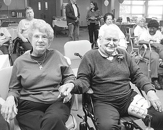 Music makes this a party: Mr. and Mrs. Harnichar enjoy the music at a special Mothers/Fathers Day party at the Antonine Sisters Adult Day Care in North Jackson. The party began at 10:30 a.m. June 9 with music and dancing, followed by a meal of tossed salad, ham, mashed potatoes and green beans. Door prizes were available for drawings, including a $20 gift card donated by the Giant Eagle store in Austintown, a candle set, a candle holder and a gift certificate for the day care beauty shop. A towel set, picnic basket, bath set and chocolate candies were all donated by Wal-mart in Austintown. Cakes and desserts, also from Wal-mart, helped to make the party special. An added touch was boutonnieres for the men, donated by Crystal Vase.