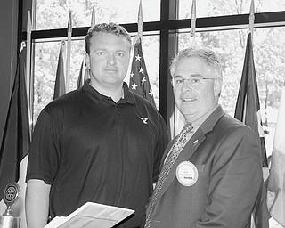 Game plan outlined: Boardman Rotary Club welcomed Eric Wolford, left, football coach at Youngstown State University, to its June 11 meeting, where he spoke of plans for the 2010 season and of his decision to return to the Valley after 20 years. He plans to introduce several events to bring the team and community closer together. These include kids' camps, Football 101 camps for women, tailgating with the players, and his own foundation to support children with special needs. He said the Valley is a great place to raise his kids. He complimented Ron Strollo, YSU athletic director, for his support in preparing top-rate facilities that will help bring high quality recruits to the team. Thanking the coach for spending time with the group was Bob Mastriana, club president.