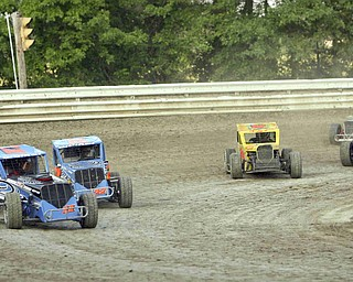 ROBERT K. YOSAY | THE VINDICATOR..Running fast and wheel to wheel drivers jockey for position at Deerfield Raceway on the outskirts of Deerfield on State Route 224 .-30-