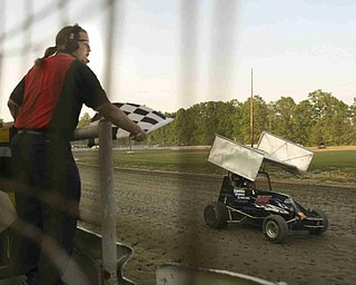 ROBERT K. YOSAY | THE VINDICATOR..Running fast and wheel to wheel drivers jockey for position at Deerfield Raceway on the outskirts of Deerfield on State Route 224  signals the winner in the  .-30-