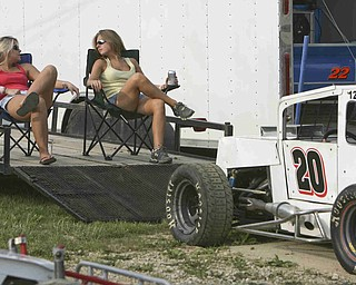 ROBERT K. YOSAY | THE VINDICATOR..Cool seats as lawn chairs on the car trailer as Amber Butcher of Cortland and Amanda Dunbar  of Kinsman  pass the time waiting for the races to start -30-