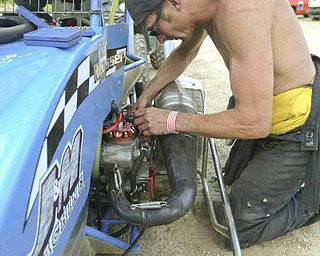 ROBERT K. YOSAY | THE VINDICATOR.. Pit Crew / Driver  Tod Reusser of Minerva adjusts the carburetor jets on his engine before the race.  -30-