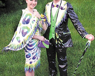 Sara Cummings of Springfi eld and James Ludt of Struthers strike a pose in duct-tape attire on their way to Cardinal Mooney's prom. The two are fi nalists in the 10th annual Stuck at Prom scholarship contest and could win $3,000 each. Online voting in the contest begins today.