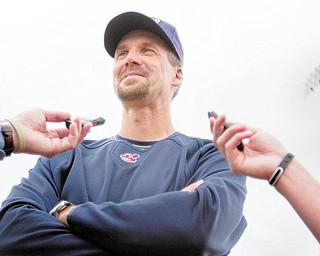 Travis Fryman, manager of the Mahoning Valley Scrappers, talks baseball with reporters during the team's media day Thursday at Eastwood Field in Niles.