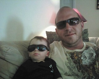 This is Allen Holtzman and son, A.J. Allen, a former Poland resident, now lives in Charlotte, N.C., with A.J. and his wife, Mindy.