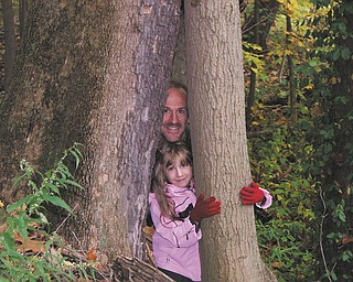 Rob McKenna of Girard and his 7-year-old daughter, Angela, enjoyed an outing at Liberty Park.