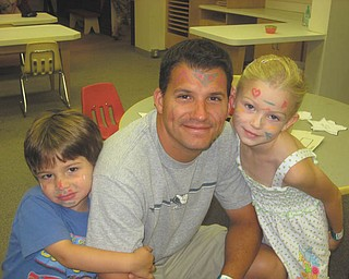 Tony Perry of Salem joins in the fun with his kids, Abby and Anthony.