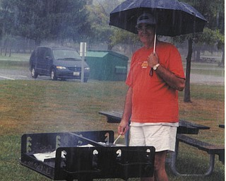 John Tabak of Campbell was such a good sport to stay out and cook for his family as they all waited under cover.