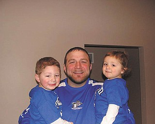 Nick Blanch, Poland High School girls' basketball head coach, is holding Nicholas and Cassie, his favorite Bulldog fans!