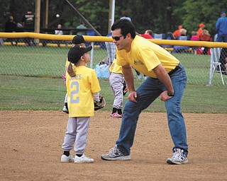 Samantha Jones, 6, is getting some T-ball advice from her coach — and  dad — Gary Jones of Canfield.
