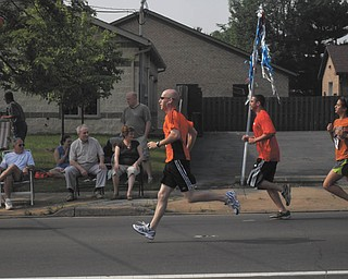 Michael Sweeney of Boardman, father of McKenna, 5, ran in the Memorial Mile on Memorial Day 2010.