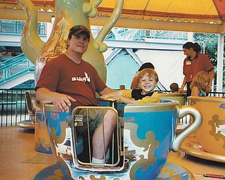 Nicholas Peskor, 8, says his dad, Roger Peskor of Youngstown, will do just about anything for him —  including taking a ride in a teacup!