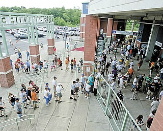 A crowd of Mahoning Valley Scrappers' fans streams through the gates of Eastwood Field in Niles for the team's home opener against the Auburn Doubledays of Auburn, N.Y.