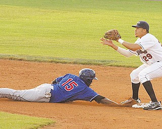 Aaron Fields (29) of the Mahoning Valley Scrappers waits for the ball as Markus Brisker of the Auburn Doubledays slides safely back to second base during Wednesday's game at Eastwood Field.
