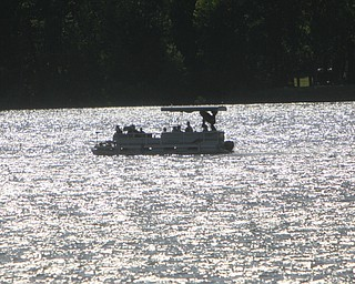 ROBERT K. YOSAY | THE VINDICATOR..IN FOCUS .  A pontoon boat  catches the setting sun lon Berlin Lake. ..-30--