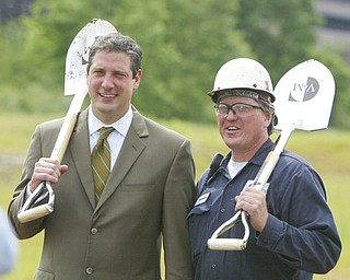 ROBERT K. YOSAY | THE VINDICATOR..Tim ryan  poses with Frank Schubert after the ground breaking of - .V & M and its parent company, Vallourec, will host dignitaries from federal, state, county and local government, along with partners in the business community and more than 100 employees for a groundbreaking ceremony to officially begin construction of the companyÕs new mill..The planned mill Ñ a state-of-the-art, hot-rolling, seamless pipe mill Ñ represents a $650 million investment for Vallourec and will lead to the creation of 750 construction and permanent mill jobs. -30--